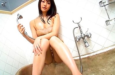 Asakura Mina Asian takes a shower over long lingerie and smiles